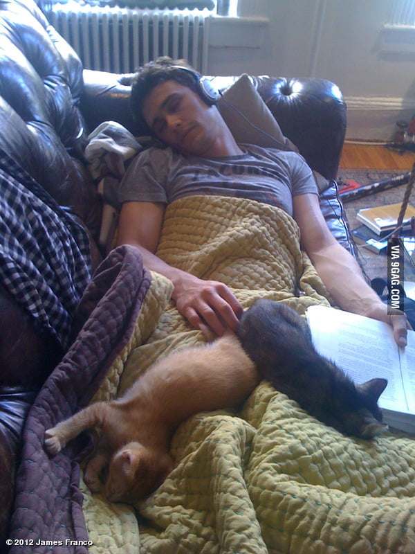 Just James Franco sleeping with his cats.