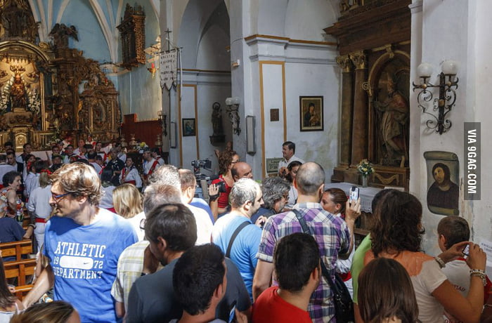 "Hundreds of tourists visiting the ""enhanced"" Jesus fresco"