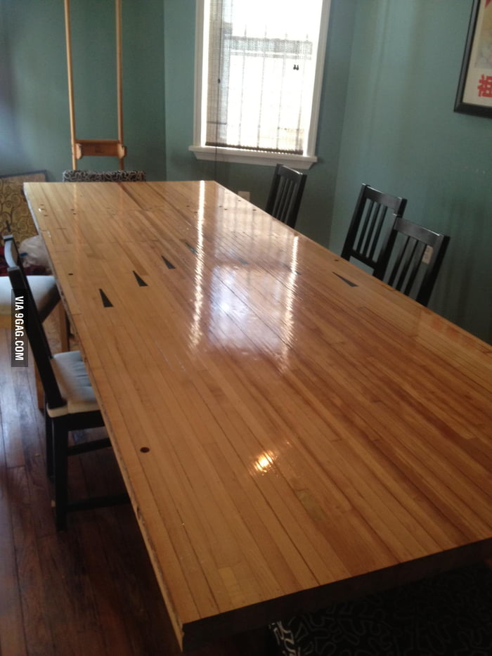 A piece of a bowling alley turned into a dining room table