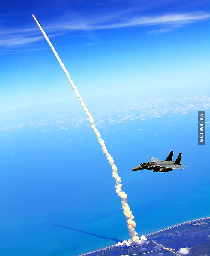 Shuttle launch seen from F15 in the sky.