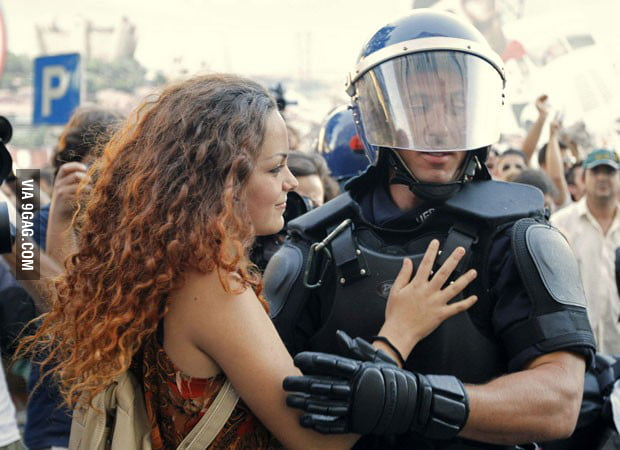A Portuguese protester hugging a police officer