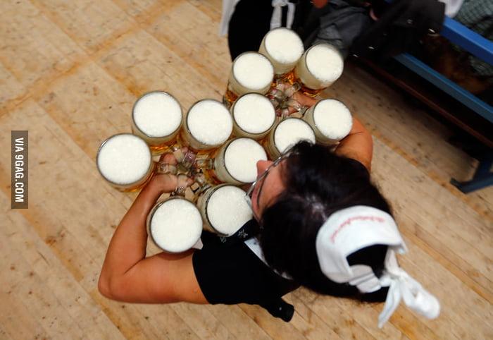 An Oktoberfest waitress carries 6 liters of beer in each han