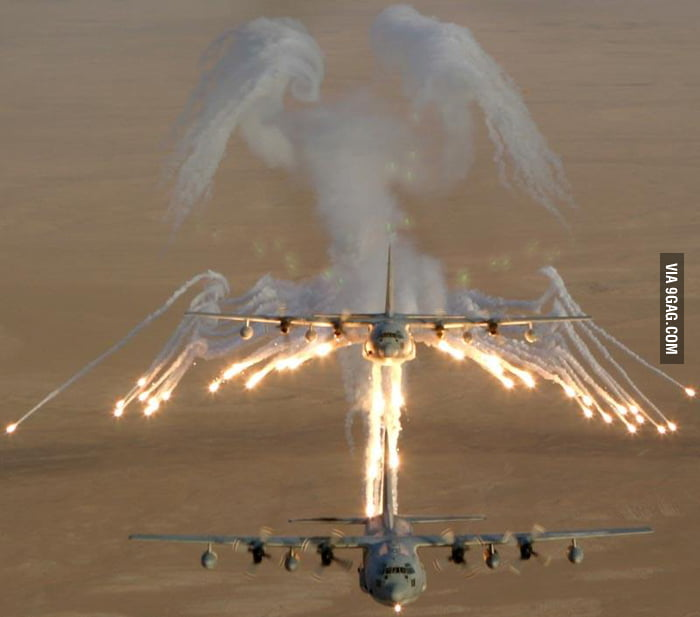 "Lockheed AC-130 leaving behind flare ""Angel of Death""."