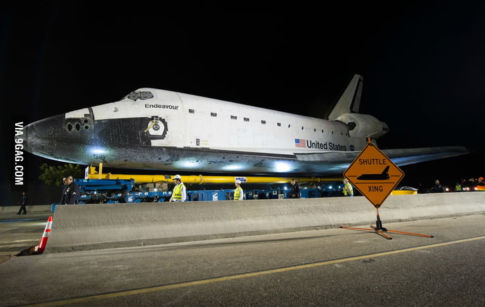 I bet that shuttle sign doesn't get used very often.
