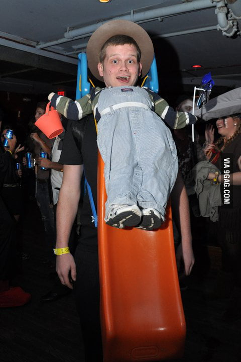 Dressed up as a boy sliding down a slide