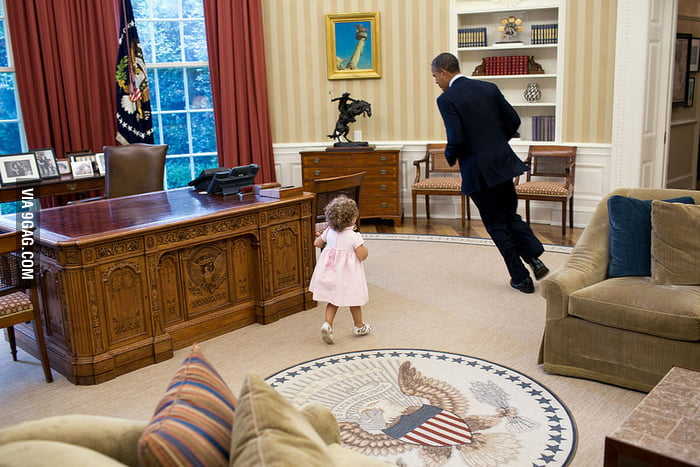 President Obama was having fun with a kid in his office.