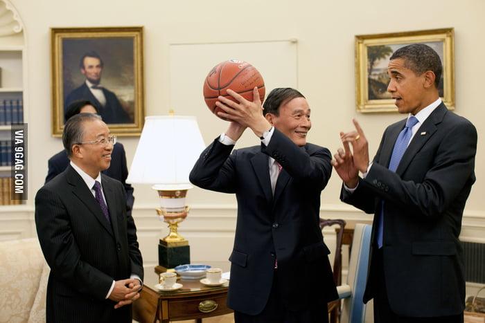 President Obama teaching Chinese Vice Premier basketball.