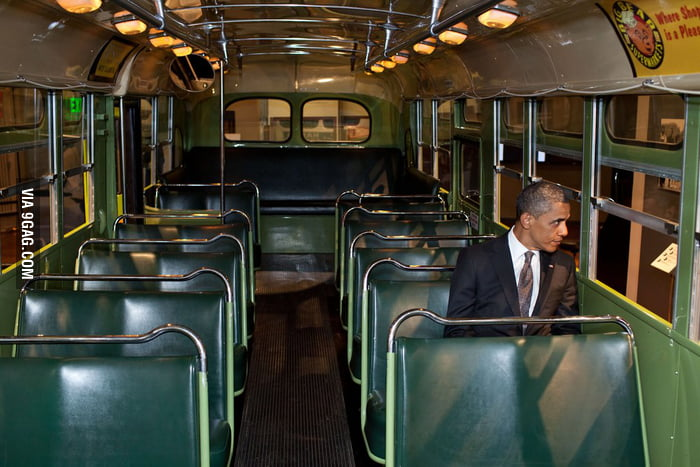 Obama sitting in Rosa Parks' seat.