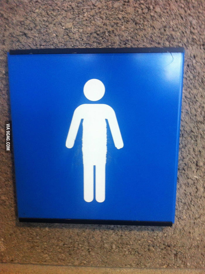 Some guy scratched the skirt off the bathroom sign. Damn!