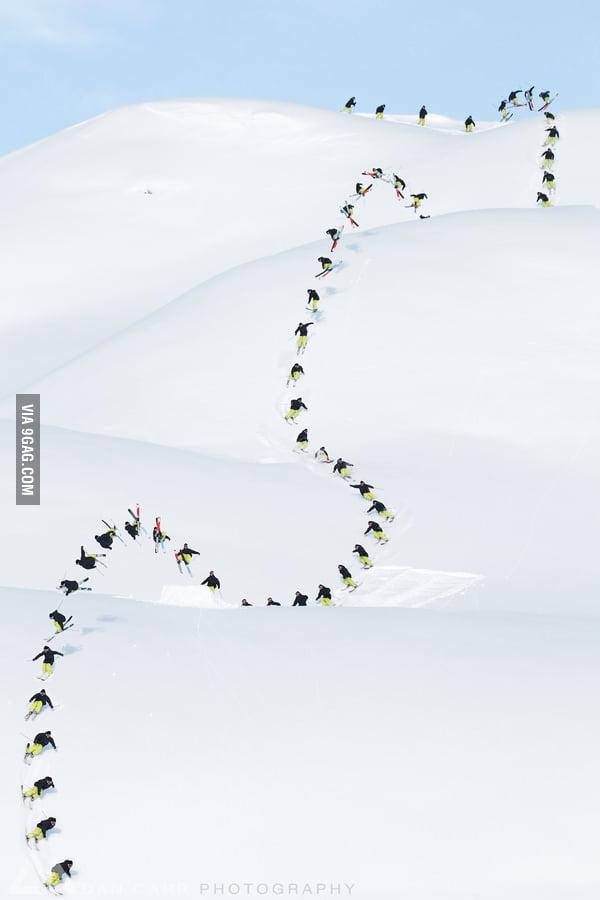 50 shot sequence of a skier descending a slope.