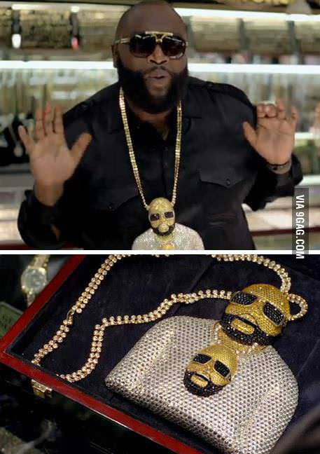 Rick Ross wearing a chain of himself wearing a chain of...