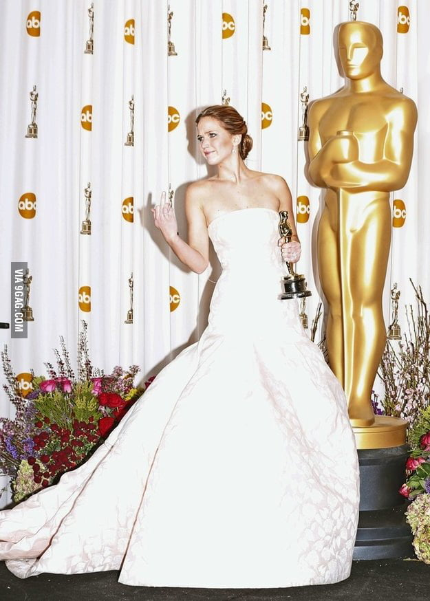 Awesome Jennifer Lawrence flips off the press
