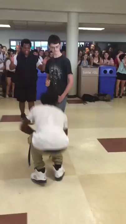 Guy shows kid how to dance