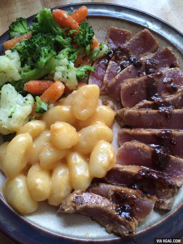 Marinated tuna steak with garlic butter gnocchi and steamed veggies ...