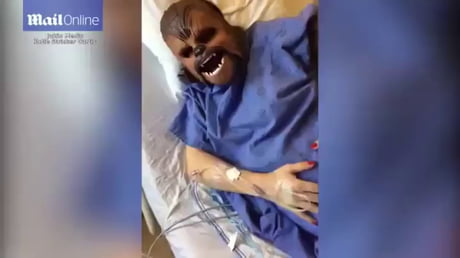 Woman puts on Chewbacca mask during labour.