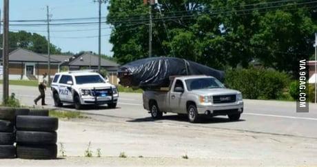 A truck hauling a car in a pretty unusual way. Hamilton, AL. Only in Alabama.