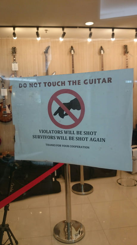Found this sign on a guitar shop door. what you guys think?