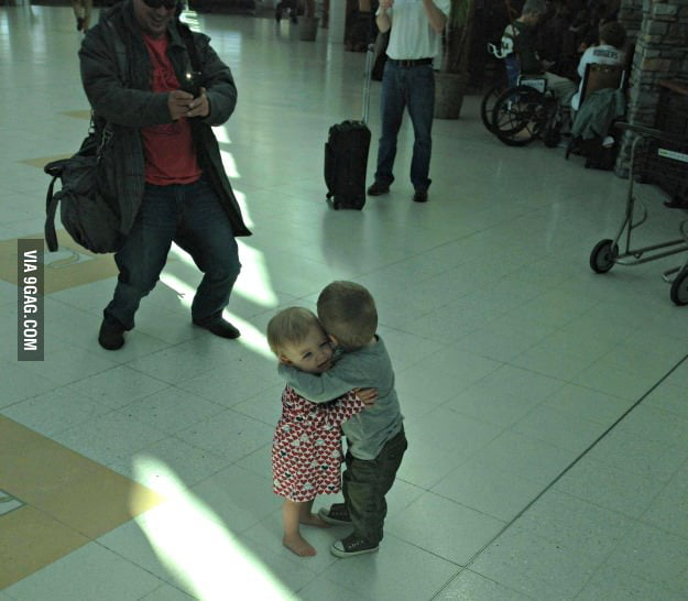 They had never met before, but decided to hug it out in the middle of an airport terminal.