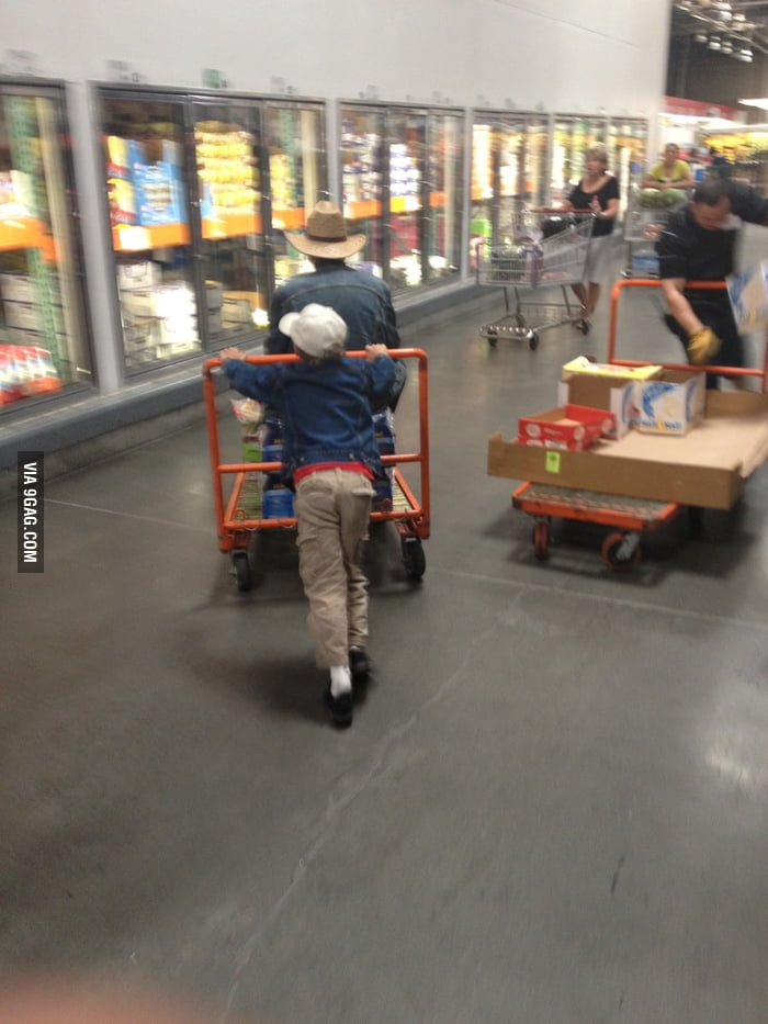 Kid pushing his father on cart while his father swears at hi