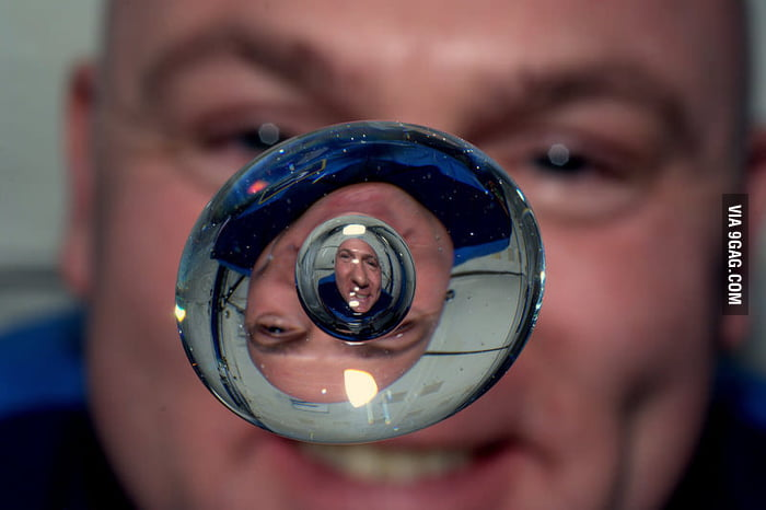A bubble of air inside a droplet of water in space.