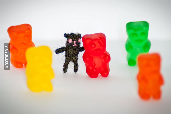A tiny teddy bear that is smaller than a gummy bear