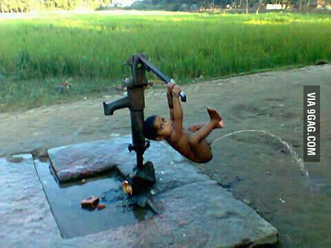 Haha, look at the boy playing with the water pump...wait!