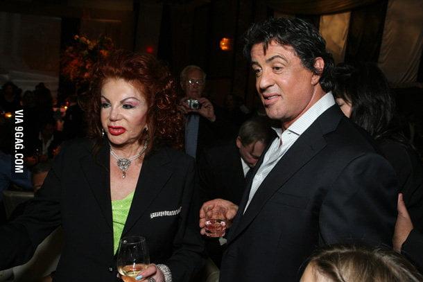 Sylvester Stallones mom looks like Carrot Top in drag