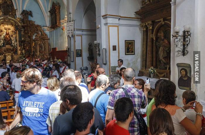 """Hundreds of tourists visiting the """"enhanced"""" Jesus fresco"""