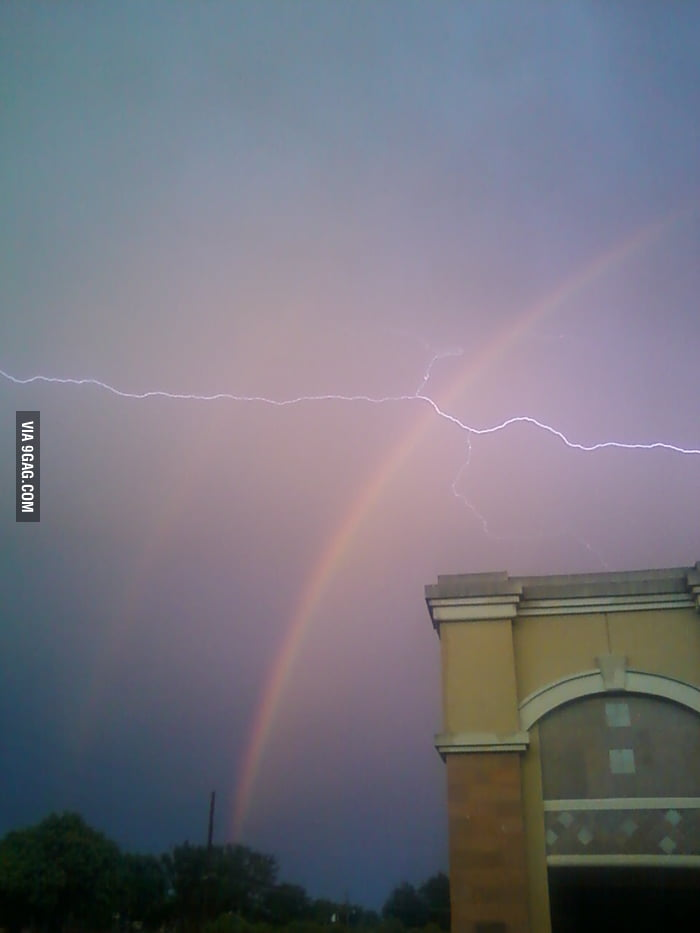 Perfect timing which captures double rainbow and lightning.