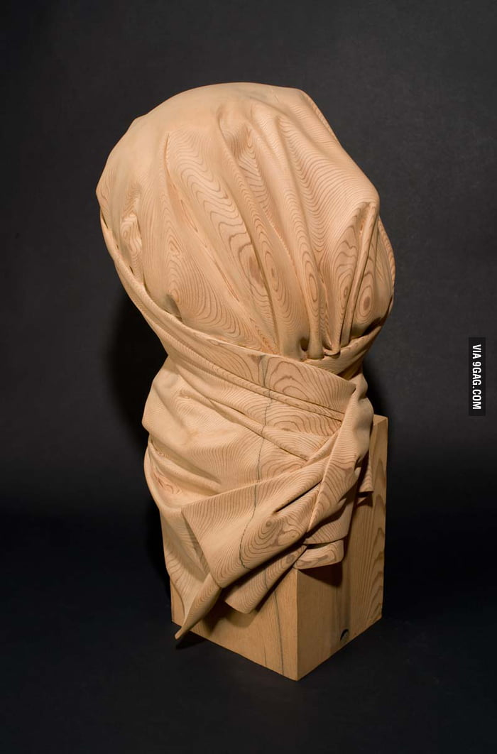 This isn't a cloth covering something, it's a wood sculpture