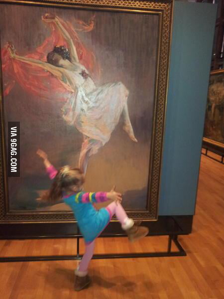 Little girl dances with painting