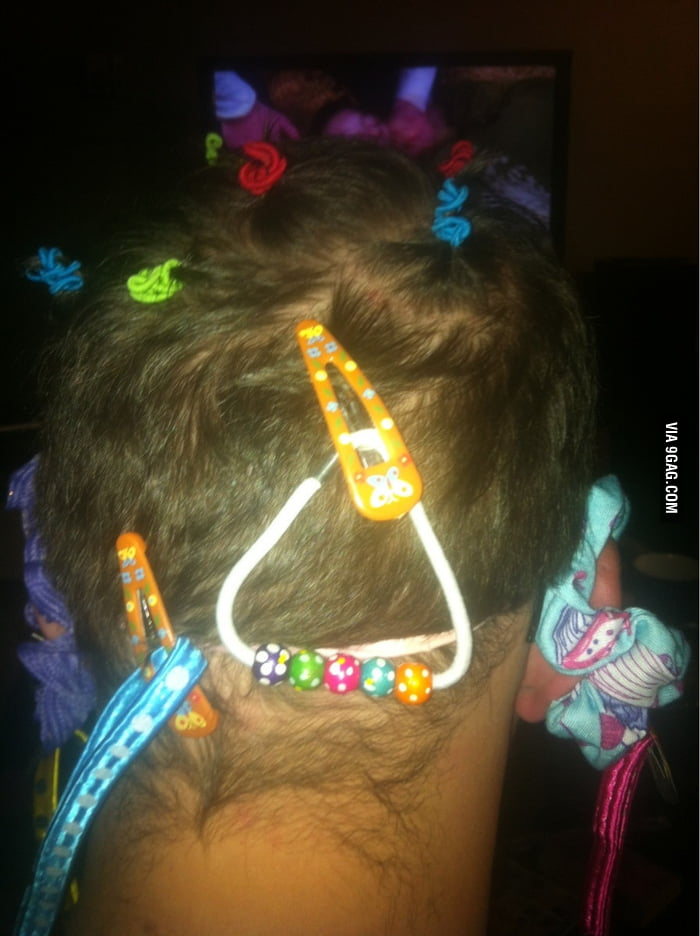 When a 7 year old daughter helps her father do the hair.