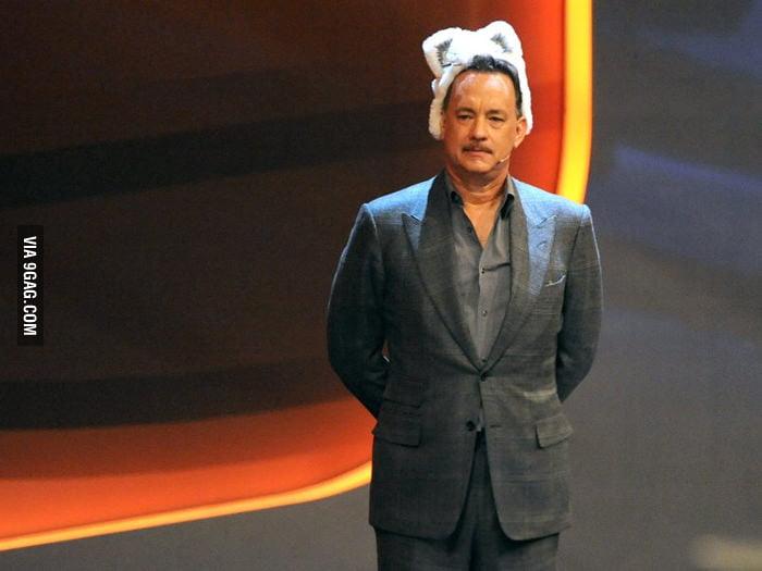 Tom Hanks wearing a fur-hat with kitten ears.