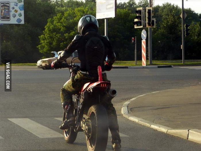 That's one way to secure passenger on your motorcycle.