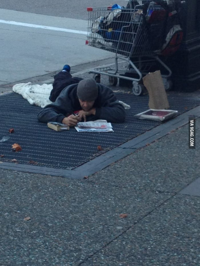 This homeless guy was enjoying his crossword.