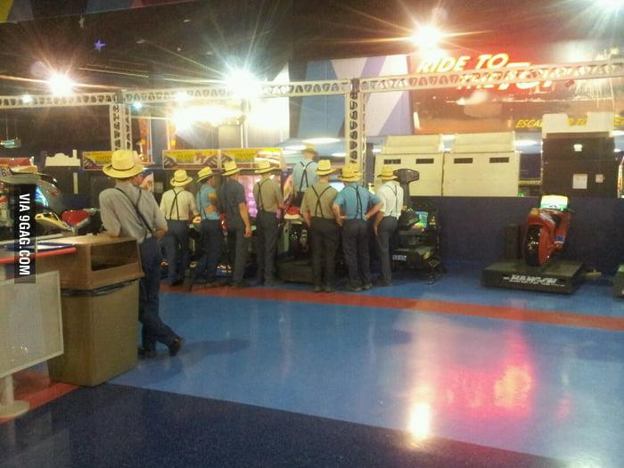 Just some Amsih gentlemen playing arcade games.