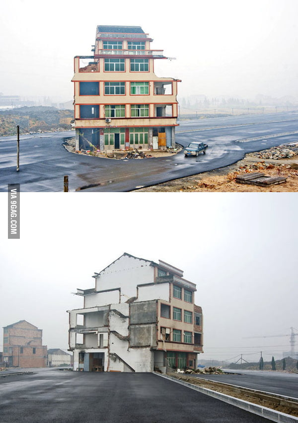 Homeowners refuse to relocate for the road. Zhejiang, China.