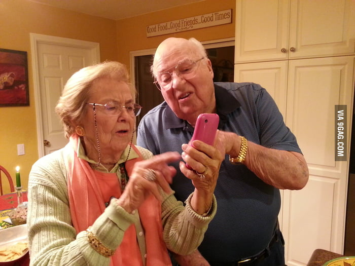 Grandparents figuring out their new iPhone.