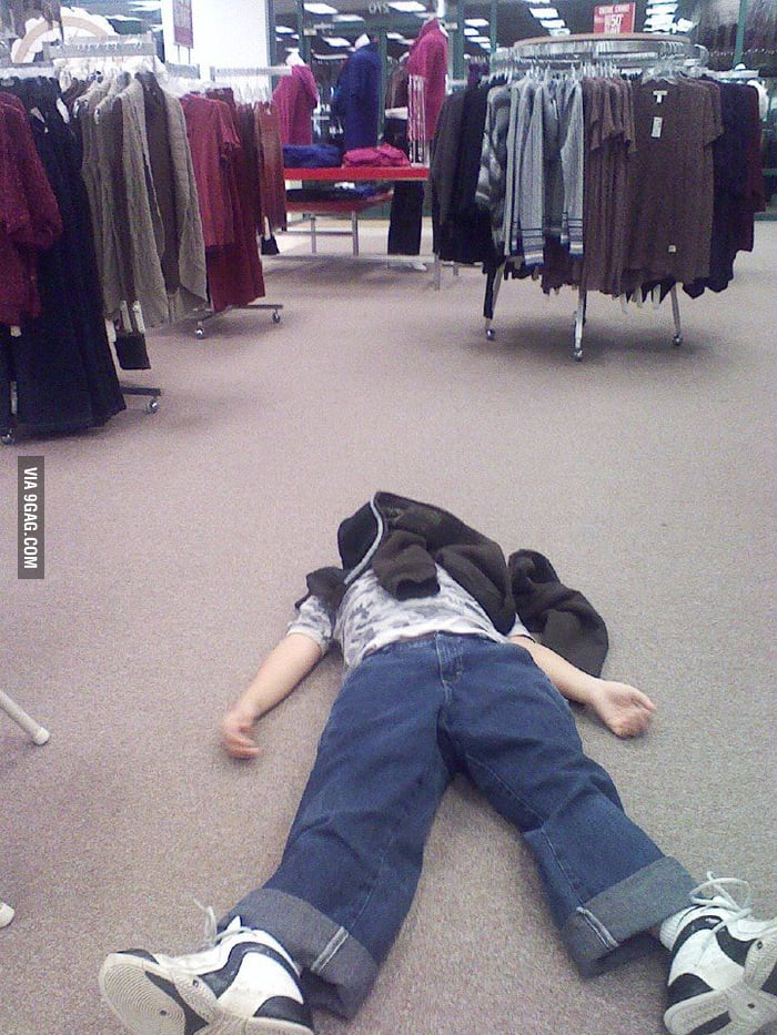 My little brother waiting for my mom to finish shopping.