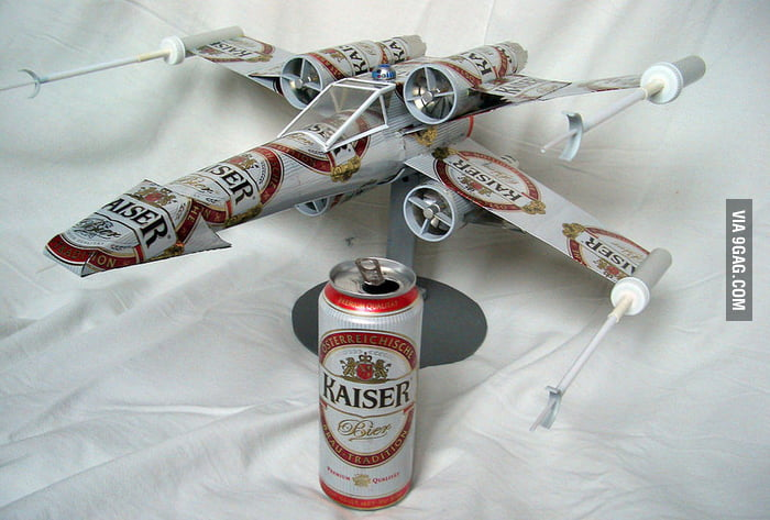 Model fighter made of recycled beer cans.