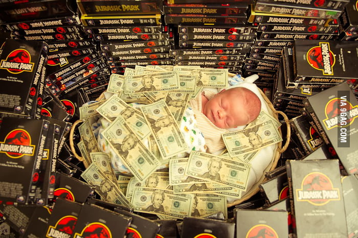 Can someone explain this picture of a baby covered by money?