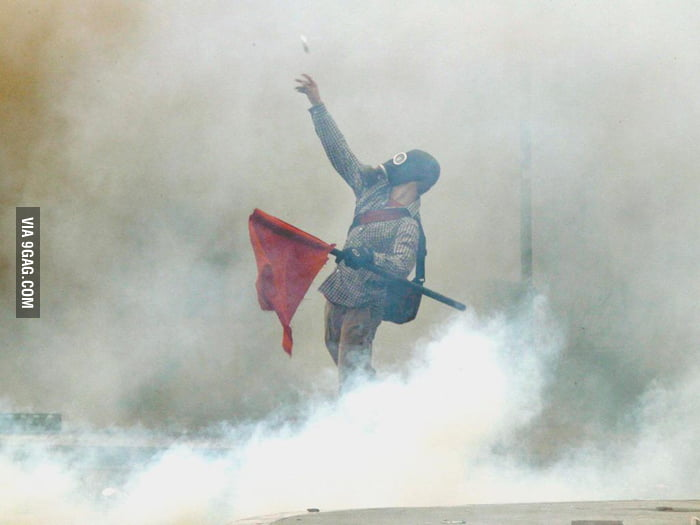 Greek protester in a sea of tear gas.