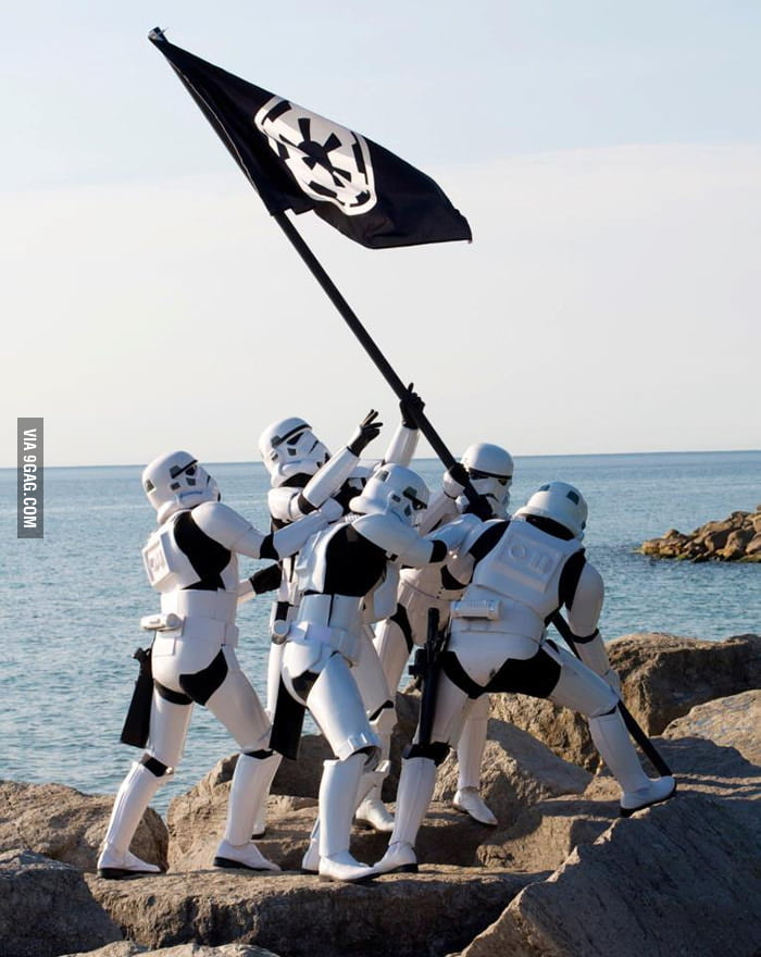 Stormtroopers raising the flag.