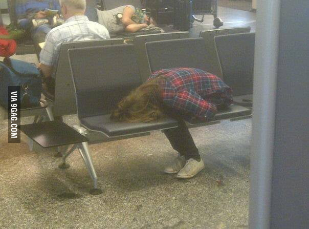 Taking a nap at the airport.