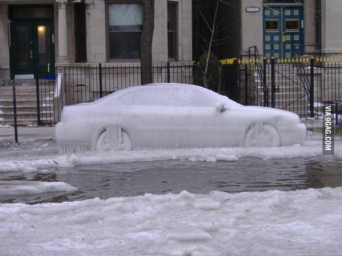 It's not an ice sculpture, it's a frozen car.
