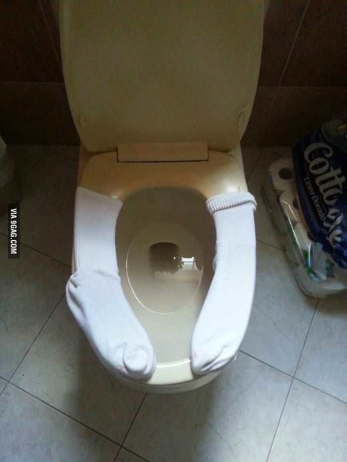 Keeping The Toilet Seat Warm With Socks 9gag