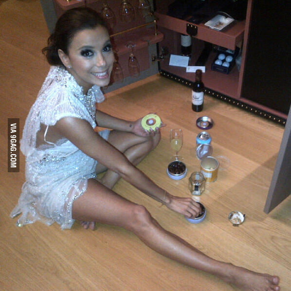 Eva Longoria raiding the mini-bar in a hotel room.