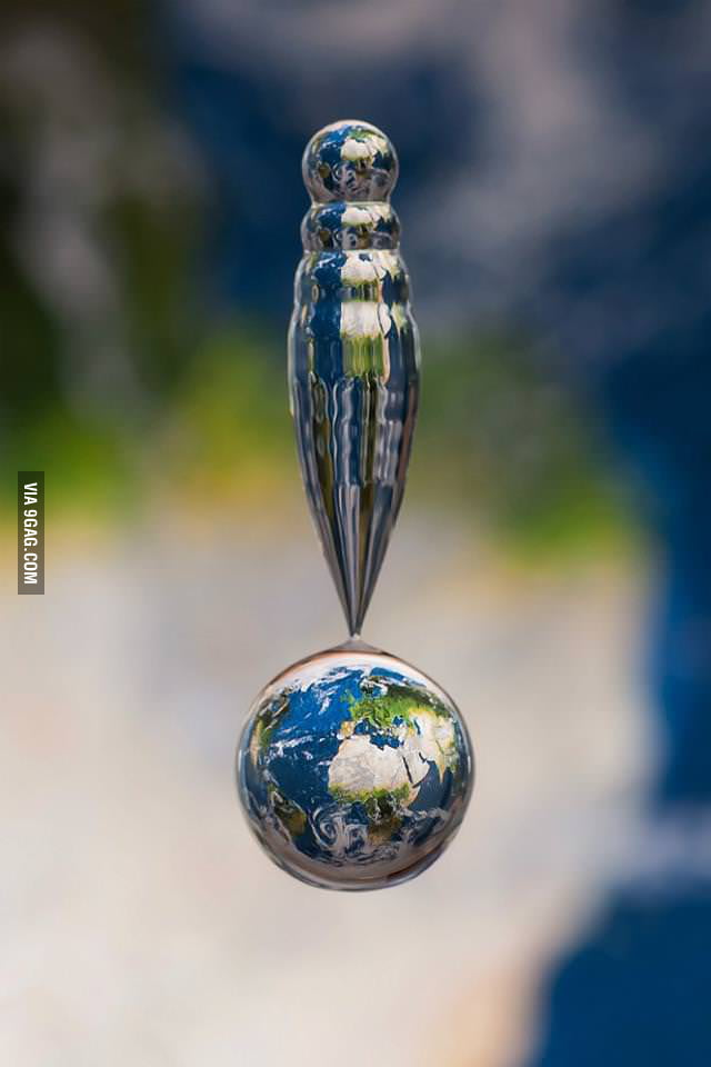 A picture of a water drop above a map
