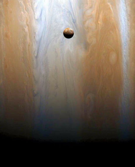 The little moon Io with his mother jupiter from the sond Cassini