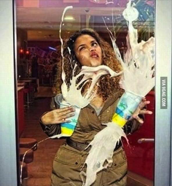 Woman Holding Milkshakes Walks Into A Glass Door 9gag